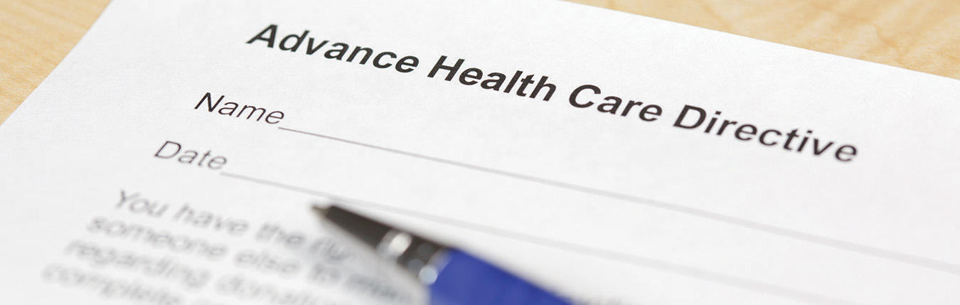 "A piece of paper titled ""Advance Health Care Directive"" and a pen. Note: Shallow focus on the word 'Health'."